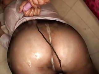 Asian stewardess plays with a vibrator