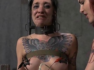 Slave bitch and her mistress have fun in sex dungeon