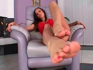 Beautiful girl playing with her pretty feet