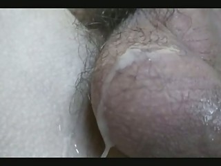 Horny twink shoots jizz all over his hairy baLLS