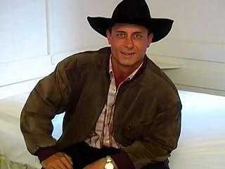 Gay cowboy gets rid of his clothes