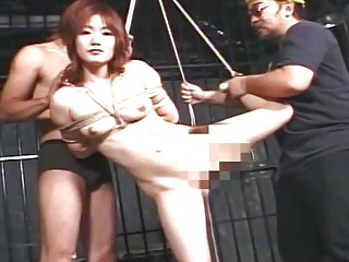 All smiles even if she is tied up by her masters
