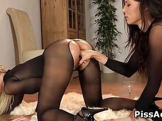 Lesbian pees on a friend and rubs her pussy with bottle