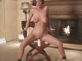 Sexy shorthaired Crissy Moran gets too hot to handle on the fireplace