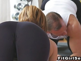 Lesbians tribbing and fingering in gym