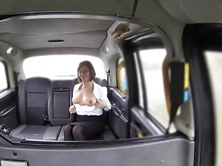 Busty bimbo gets nailed in back of the fake taxi