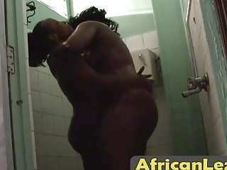 Chubby African lesbians Nelly and Natasha shower