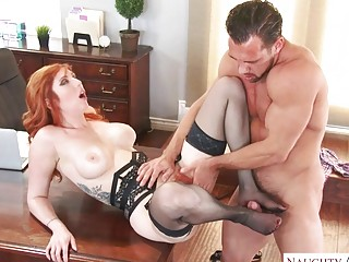 Foxy redhead has her tight ass ravaged in an office