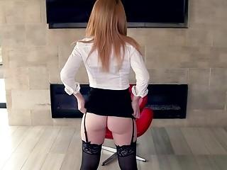 Stunning lady in stockings and garter belts vigorously sucks dick