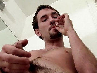 Young gay Paradox lights cigarette and masturbation
