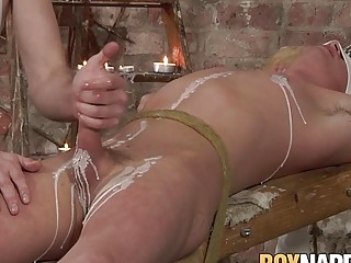 Young BDSM dom torments and blows restrained sub
