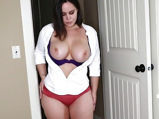 Gorgeous MILF with huge tits shows off solo while stripping