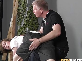 Young sub cums as his cock is stroked by his older lover