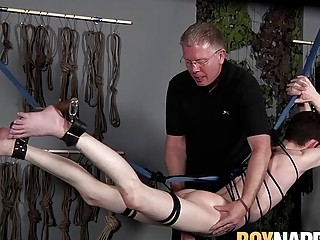 Submissive man punished by his master with ropes and wax