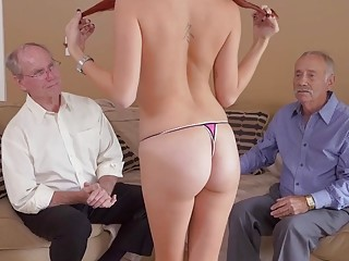 Cute redhead with glasses pleasures old men in a threesome