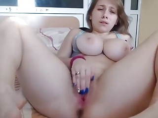 Lovely amateur chick with big tits masturbates on a webcam