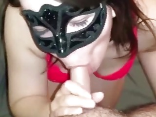 Masked wife giving a passionate blowjob