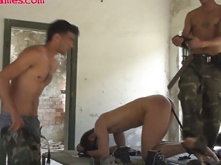 Two military men are scoffing at a guy and fucking him